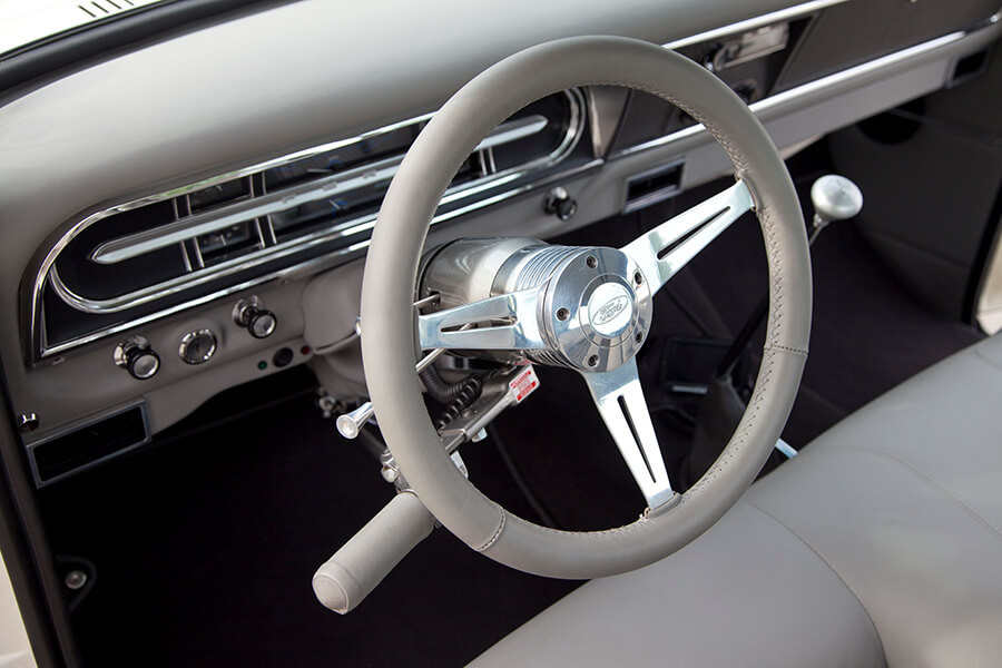 Custom Ford F-100 with steering wheel cover matching the interior