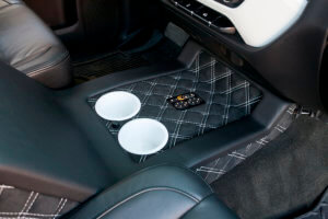 Detail of the interior showing quilted leather on the part housing the truck's cup holders