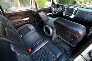THE INSIDE OF THE TRUCK IS ALL LEATHER AND SUEDE, AND THANKS TO THE DIAMOND STITCH PATTERN, IT LOOKS LIKE IT BELONGS IN A SUPERCAR.