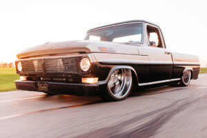 Julio Garcia's custom 1970 Ford F-100 running on the street.