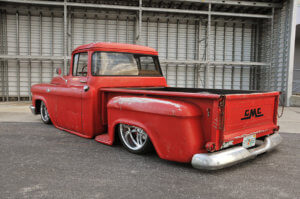 Rear view of Jeff Crumpler's custom 1958 GMC 100 with the red patina'd exterior.