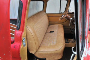 Reupholstered interior with plaid inserts on the seats, shifter and door panels.
