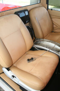 John Hansen of Gilbert, Arizona, wrapped the majority of the interior in custom tan leather to add smooth contrast to the textured suede finish.