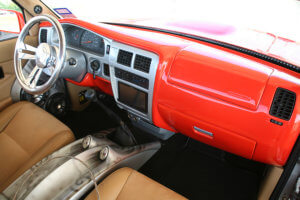 Interior showing the ultra orange and silver dashboard of the custom 1997 Toyota Tacoma