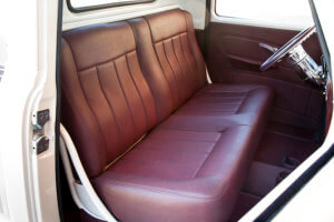 Brandy-Colored leather upholstery and custom door panels.