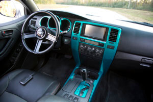 Simple and tasteful interior with Katzkin leather, a suede headliner and teal accents on the trim.