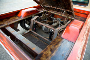 An access panel built right into the bed floor features hood hinges from a 1972 nova and a C-10 hood latch.