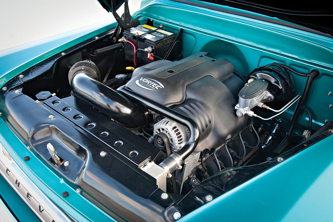 The engine compartment isn't covered in shiny accessories; it was kept clean to pull off the illusion that it originally came with this modern LQ9 engine.