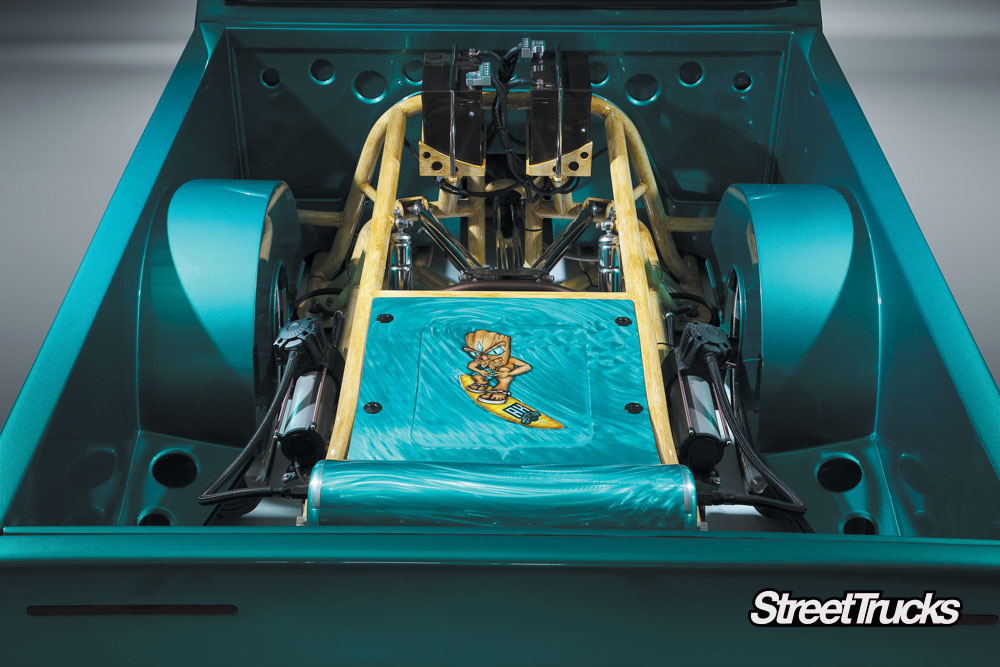 1990s turquoise Nissan hardbody truck bed with suspension