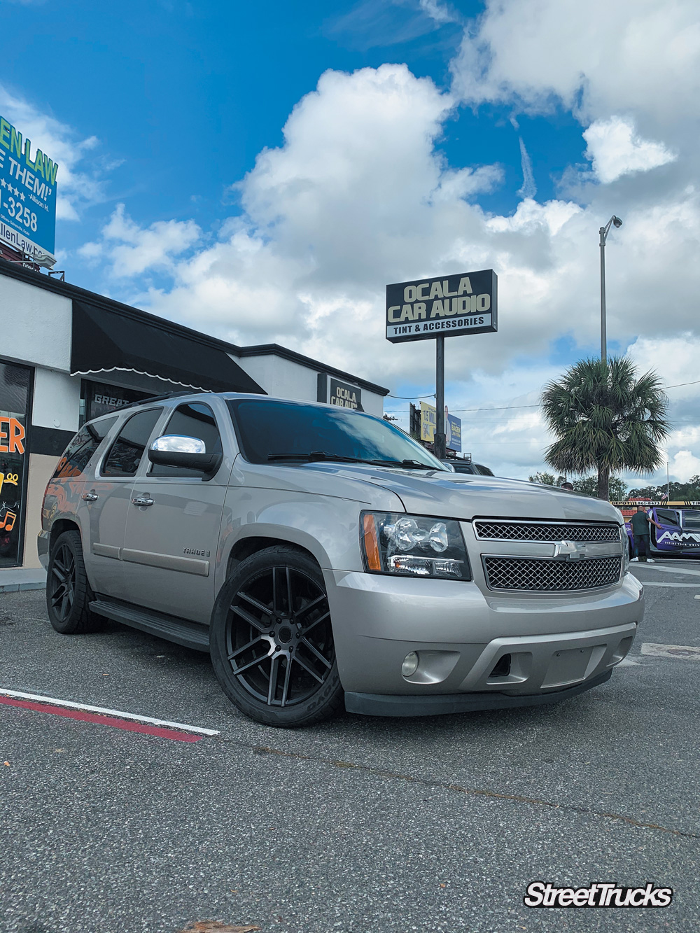 Tan Chevy Tahoe lowered with black wheels